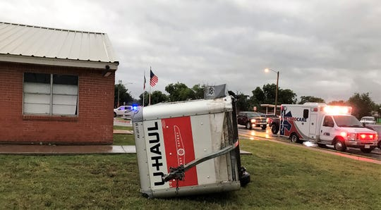 A U-Haul trailer rests on its side at Willow Springs Health and Rehabilitation Center on Seventh Streets, blown from the facility across the Winters Freeway.