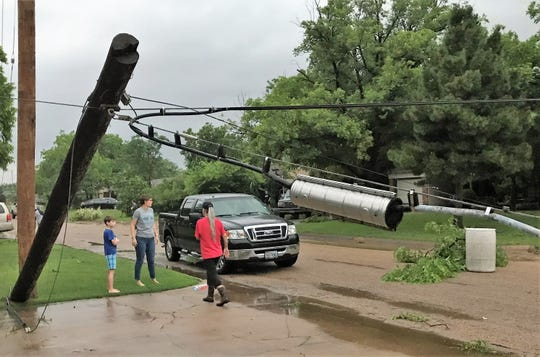 A power pole leans and lines are near street level after the early morning storm in west Abilene. There was a large power outage in Abilene, and reports of natural gas leaks.