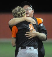 Ira coach Toby Goodwin hugs pitcher Karson Valentine (4) following a Region I-1A semifinal against Gail Borden County at Hermleigh Cardinal Field on May 17, 2019.