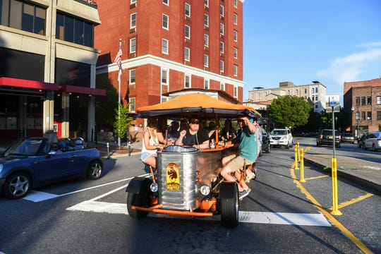 As is the case in most of America, tourism has essentially come to a halt. Some leaders and experts expert it to gradually return this summer, which will help businesses such as the Amazing Pubcycle, seen here in downtown Asheville in 2019.