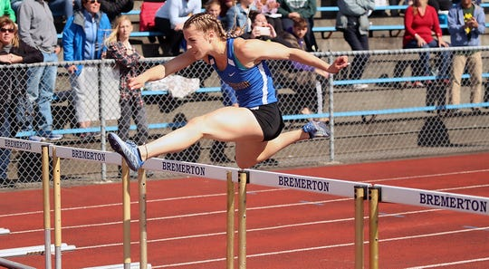 Bremerton's Lauryn Chandler soars over the final hurdle during her victory in the 2A girls 100-meter hurdles.