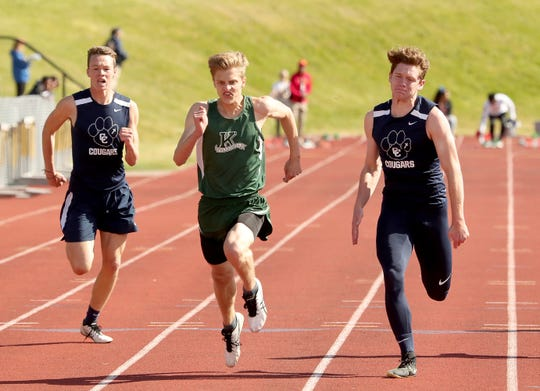 Klahowya's Dylan Jackson, center, heads for the finish line ahead of Cascade Christian's Conner Zetterburg and Donovan Scott during the boys 1A 100-meter race at Friday's West Central District track and field championships at Bremerton High School.
