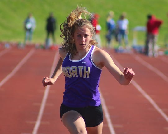 North Kitsap's Alyssa Cullen set a school record in the 100-meter dash, running 12.23 to finish third at Friday's Class 2A West Central District track and field championships at Bremerton.