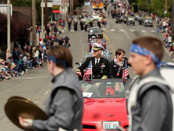 Armed Forces Day Parade Grand Marshal Admiral Frank Caldwell travels down 6th during the parade in Bremerton on Saturday, May 18, 2019.