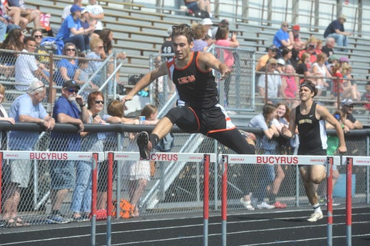Lucas senior Danny Desterhaft, in just his second year as a hurdler,  won district titles in both the 110 and 300 meter races last Saturday at Bucyrus High School.
