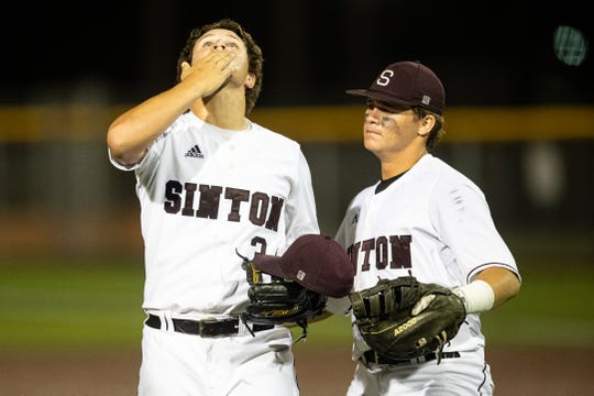 Sinton's Zach Moses looks up to the sky after defeating Robstown 5-3 in the first of three game playoff services Friday, May 17, 2019.