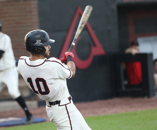 Cincinnati infielder Eric Santiago swings the bat during the Bearcats 10-4 win over Xavier, Friday, May 17, 2019.