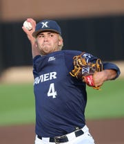 Xavier starting pitcher Conor Grammes throws the during the first inning of their baseball game against UC, Friday, May 17, 2019.