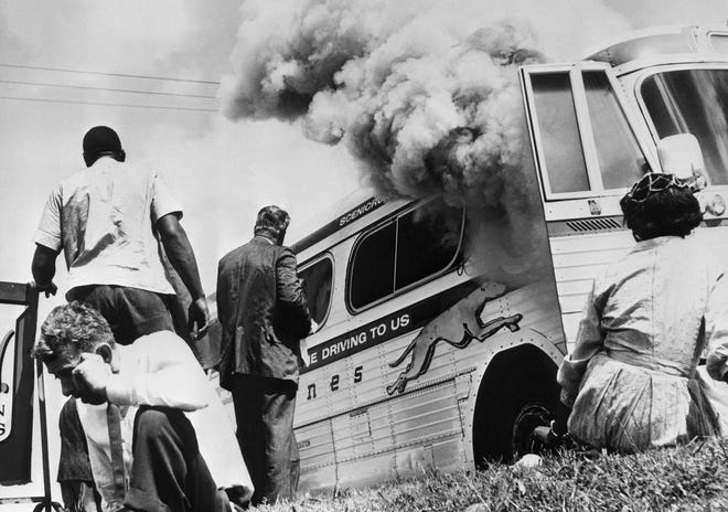 In Anniston, Alabama, an angry mob stoned and firebombed the Greyhound bus holding some of the original Freedom Riders.