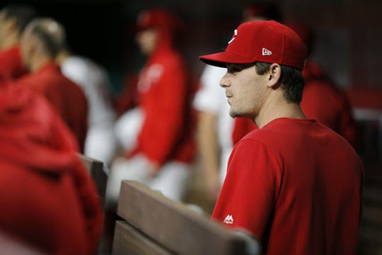Injured Cincinnati Reds infielder Scooter Gannett joins the team in the dugout dugout he seventh inning of the MLB National League game between the Cincinnati Reds and the Atlanta Braves at Great American Ball Park in downtown Cincinnati on Wednesday, April 24, 2019.