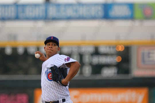 Iowa Cubs pitcher Adbert Alzolay throws a pitch during Friday night's game.
