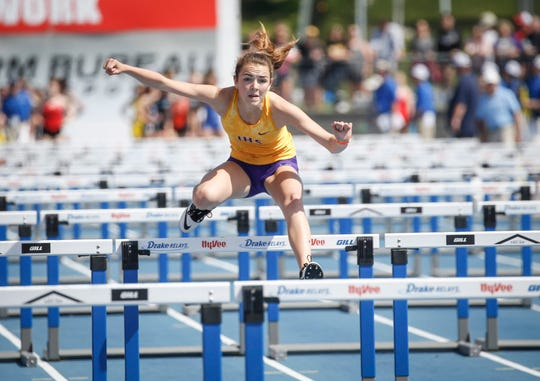 Indianola sophomore Avery Howe clears a hurdle in the Class 4A shuttle hurdle relay during the 2019 Iowa high school track and field state championships at Drake Stadium in Des Moines on Saturday, May 18, 2019.