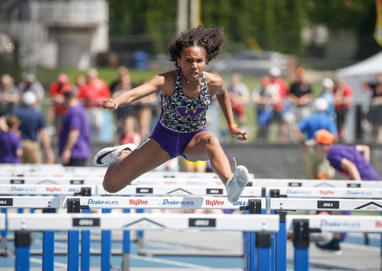 Waukee freshman Natalie Harris anchors her shuttle hurdle relay team to a Class 4A state title during the 2019 Iowa high school track and field state championships at Drake Stadium in Des Moines on Saturday, May 18, 2019.
