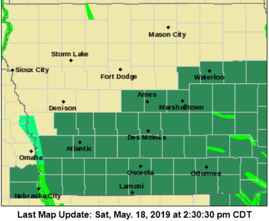 A photo of the National Weather Service's warning and watch map for Iowa. The dark-green shaded areas indicate flood watches or flash-flood watches while the light-green streaks signify greater floor risks.