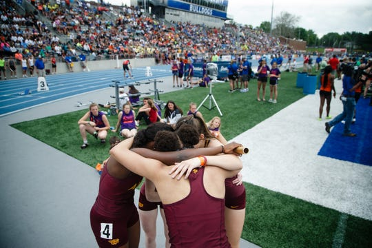 The Ankeny girls 4x100 relay team reacts to winning the race at the 2019 High School State Track Meet on Saturday, May 18, 2019, in Des Moines.