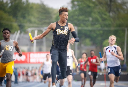 Bettendorf senior Darien Porter reacts after anchoring his sprint medley relay team to a Class 4A state title during the 2019 Iowa high school track and field state championships at Drake Stadium in Des Moines on Saturday, May 18, 2019.