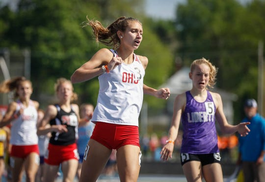 Ottumwa junior Allison Bookin-Nosbisch crosses the finish line to win the Class 4A 800-meter run state title during the 2019 Iowa high school track and field state championships at Drake Stadium in Des Moines on Saturday, May 18, 2019.