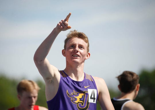 Johnston senior Joe Schaefer reacts after winning a Class 4A state title in the 800 meter run during the 2019 Iowa high school track and field state championships at Drake Stadium in Des Moines on Saturday, May 18, 2019.