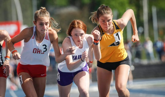 Class 4A runners battle it out at the starting line in the 800-meter run during the 2019 Iowa high school track and field state championships at Drake Stadium in Des Moines on Saturday, May 18, 2019.