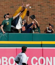 Christin Stewart watches as fans try catching the homer hit by Chad Pinder in the seventh inning.