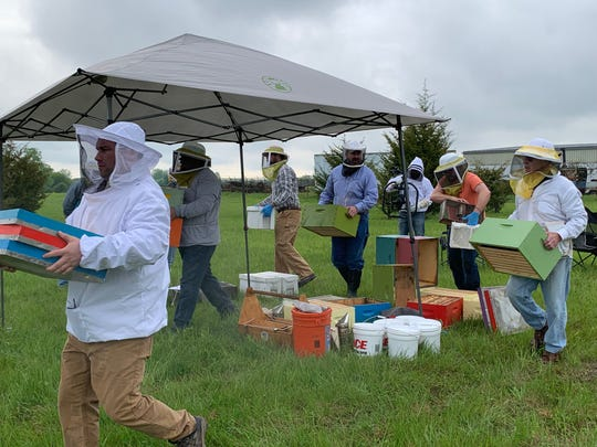 Heroes to Hives workshop participants getting ready to install new hives at Ford's Cherry Hill Farm in Ypsilanti on Saturday, May 18, 2019.
