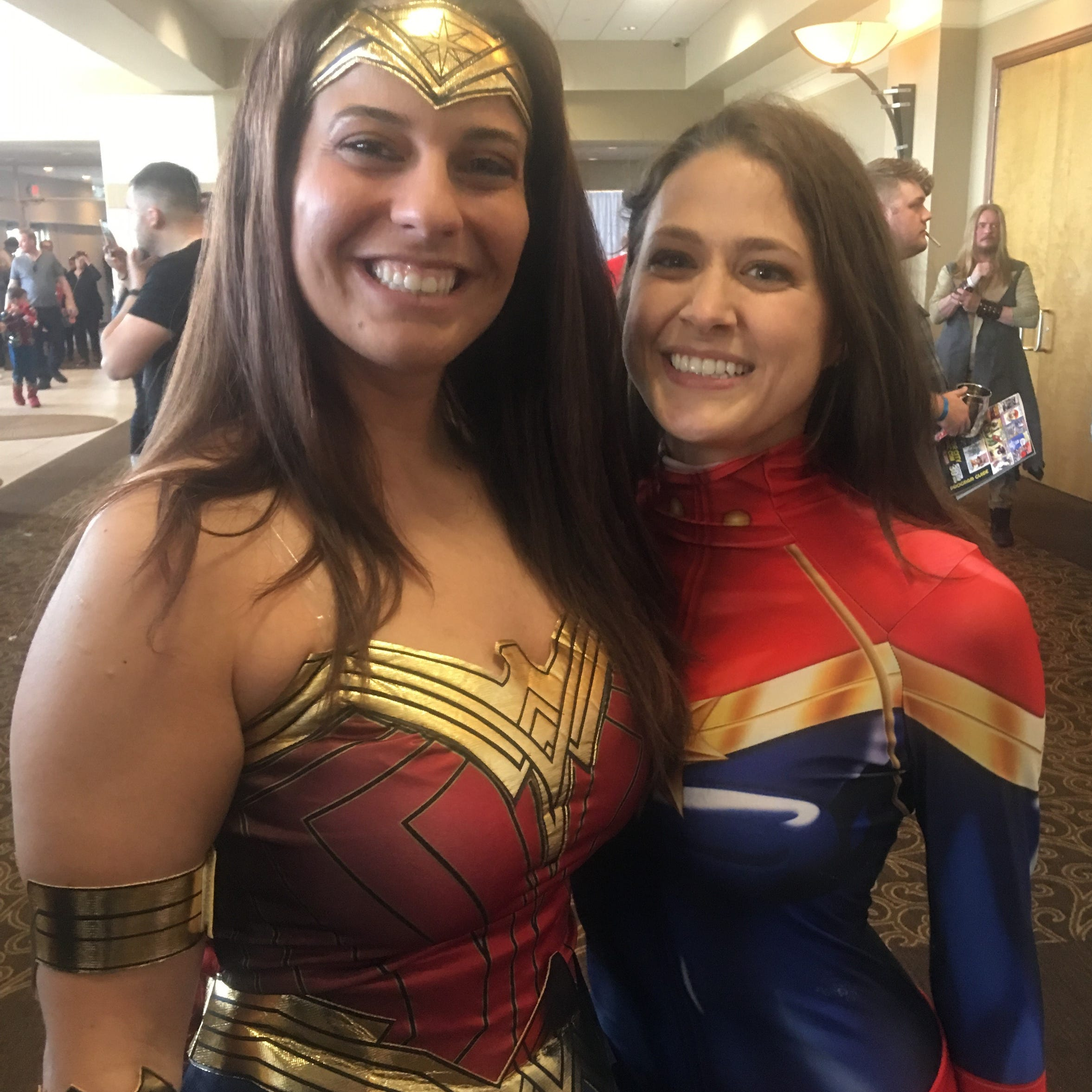 Cosplay proposal: Captain Marvel and Wonder Woman get engaged at Motor City Comic Con