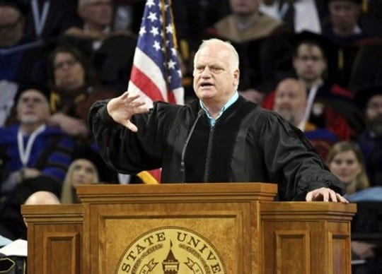 Former Detroit Lions QB Eric Hipple gives a commencement address at Utah State University in 2019.