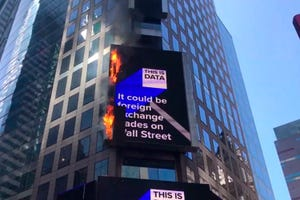 In this image from video provided by WABC TV, flames shoot from the digital billboard at 3 Times Square in New York City, Saturday, May 18, 2019.