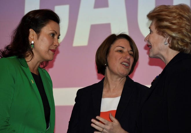 Gov. Gretchen Whitmer, left, chats with U.S. Sen. Amy Klobuchar, D-Minnesota, and U.S. Sen. Debbie Stabenow, D-Michigan, at the state Democratic Women's Caucus' 33rd annual Legacy Luncheon on Saturday at the Marriott Renaissance Center in Detroit.