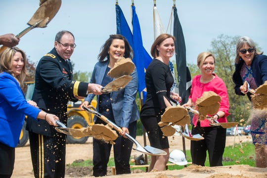 Governor Gretchen Whitmer, Senator Winnie Brinks and Grand Rapids Mayor Rosalynn Bliss help kick up the dirt on the groundbreaking ceremony of the upcoming Grand Rapids Home for Veterans on Friday, May 17, 2019 in Grand Rapids.