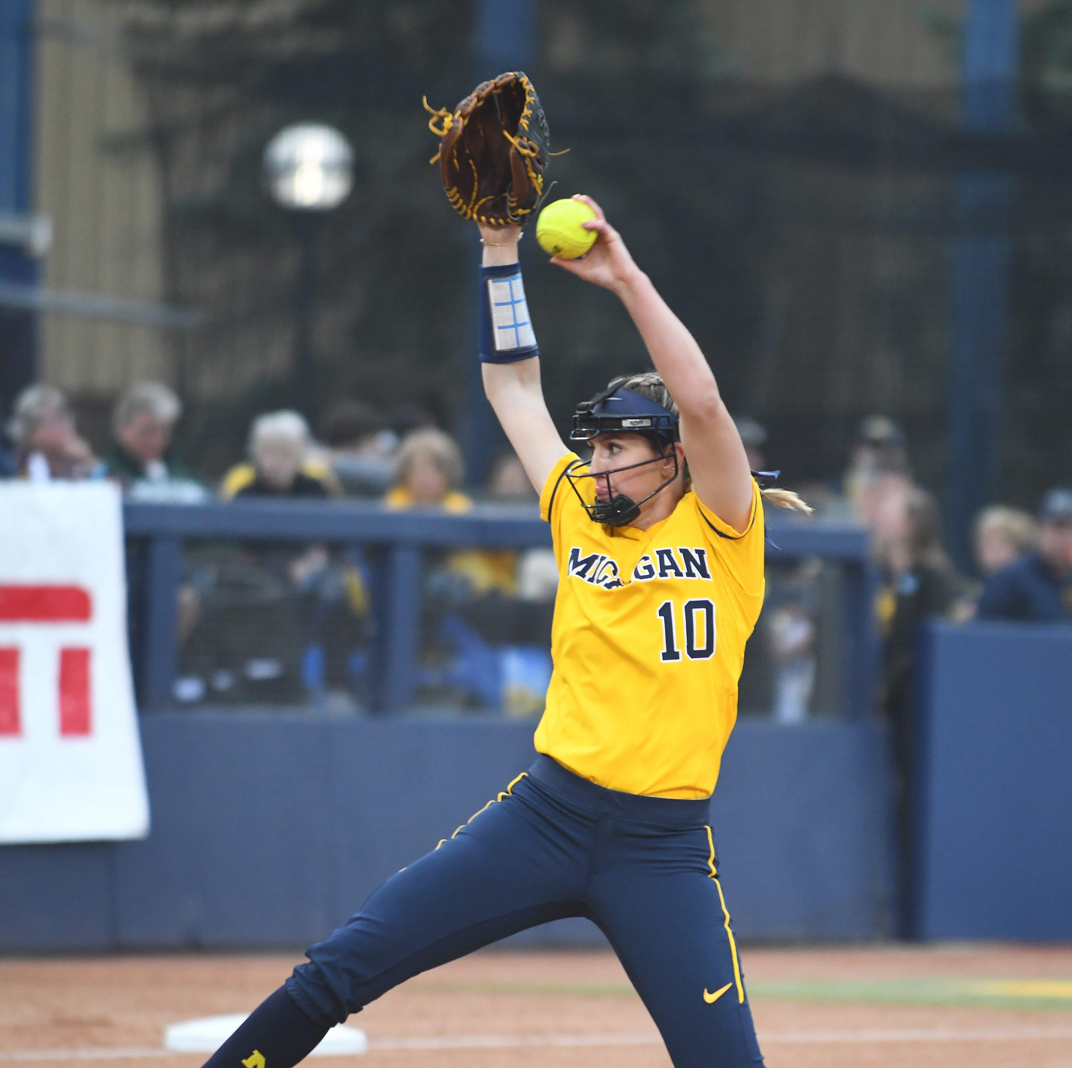 Arms duel: Michigan softball prevails in 12-inning regional marathon