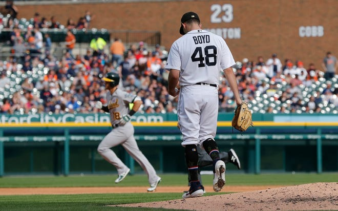 Detroit Tigers starting pitcher Matthew Boyd (48) walks off the mound as Oakland's Chad Pinder rounds the bases after a solo home run during the seventh inning.