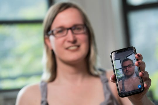 In this Wednesday, May 15, 2019, photo, Bailey Coffman shows her photo as a man in the Snapchat app during an interview in New York.