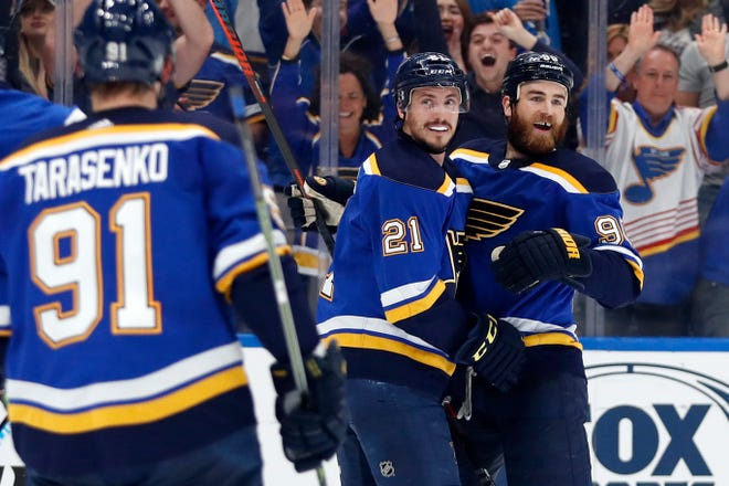 Blues center Tyler Bozak (21) celebrates with Vladimir Tarasenko (91) and Ryan O'Reilly (90) after Bozak scored a goal against the Sharks during the first period of Game 4 on Friday.