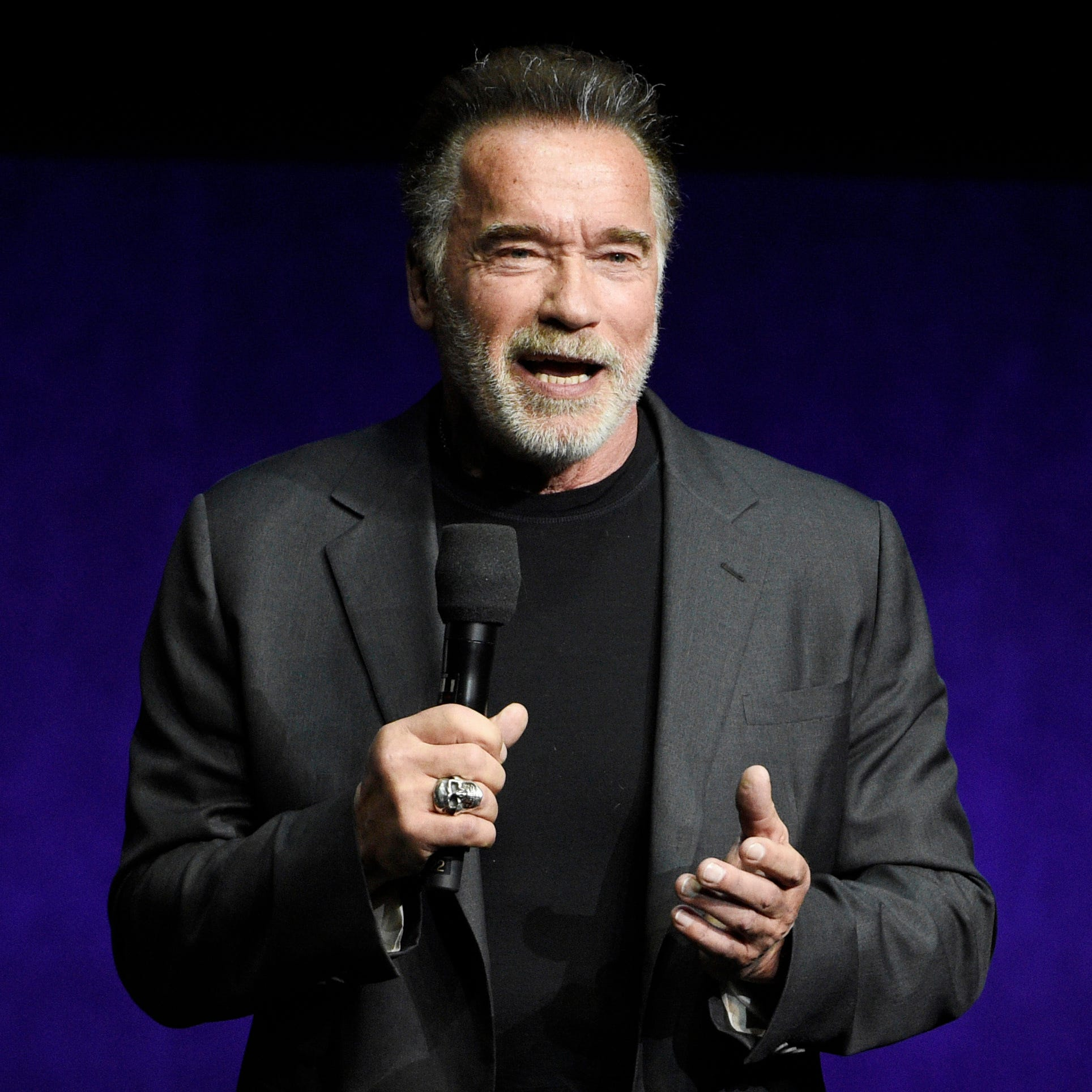 Schwarzenegger kicked in back at South Africa event; he shrugs it off