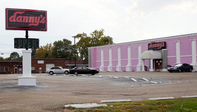 This Oct. 3, 2012 file photograph shows a few cars that are parked outside Danny's Downtown Cabaret, formerly Danny's Cabaret, in downtown Jackson, Miss.