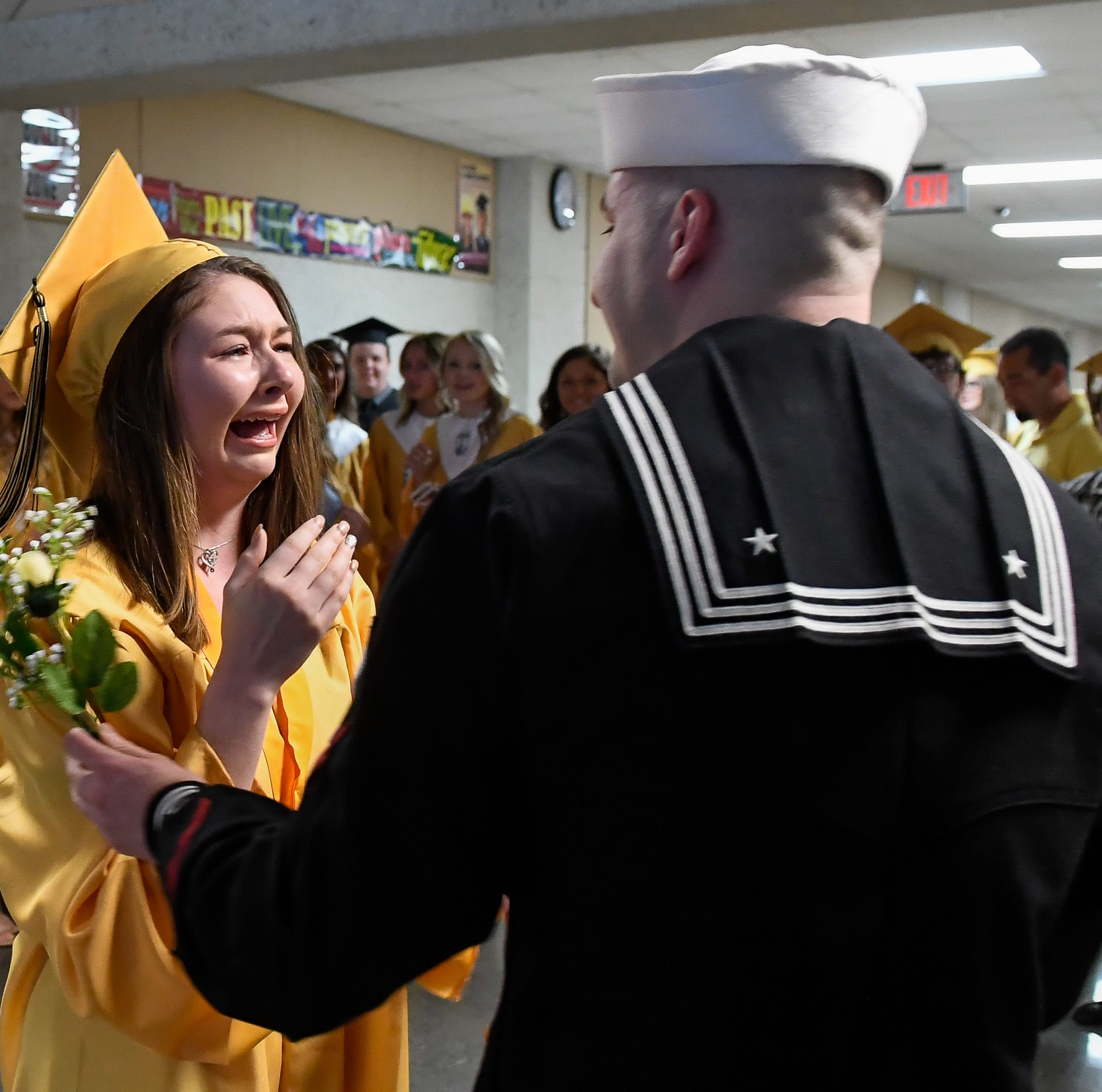 Boonville High School's Emma West surprised by Navy brother on graduation day