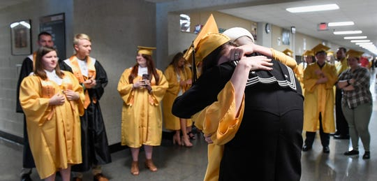 Boonville graduating senior Emma West gets a long hug after a surprise visit from her brother Blake West, who has been off serving on the aircraft carrier Harry S. Truman for the last two and a half years Saturday, May 18, 2019.