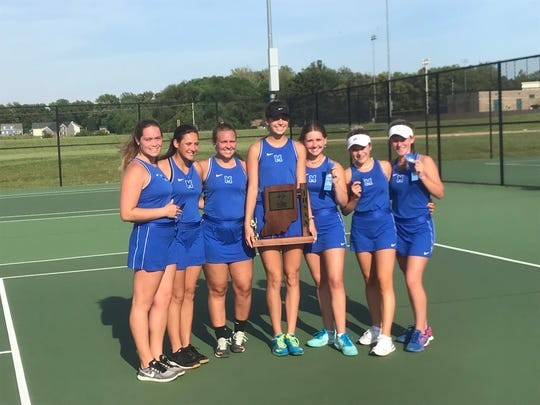 The Memorial girls tennis team celebrates its sectional championship victory against North.