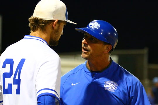 Canterbury coach Frank Turco talks with pitcher Bryce Einstein during a mound visit against ODA. The Cougars beat the Thunder in extras, 6-5.