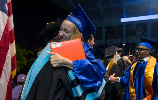 Sara Malloy, 18, hugs one of the teachers after receiving her diploma during the Cape Coral High School graduation ceremony Saturday afternoon, May 18, 2019, at Suncoast Credit Union Arena. About 360 graduates accepted their diplomas.