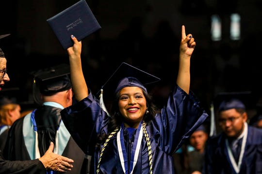 A graduate reacts as family and friends celebrated their student walked the stage.  Estero High School seniors were excited to graduate Saturday morning during their  graduation ceremony at Alico Arena, Estero, FL. About 420 students participated in the ceremony.