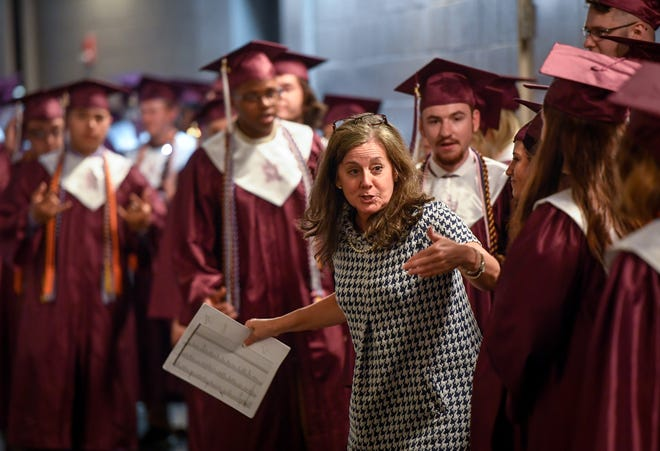 Tiffany Sights gets graduates organized at the Henderson County High School 2019 Commencement Ceremony held at the Evansville Ford Center Friday, May 17, 2019.