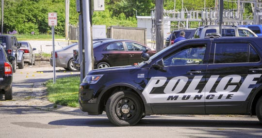 Police continue to investigate at the scene where emergency personnel were called to a reported shooting in the 2400 block of West Euclid Avenue in Muncie at about 12:45 a.m., Saturday, May 18, 2019.