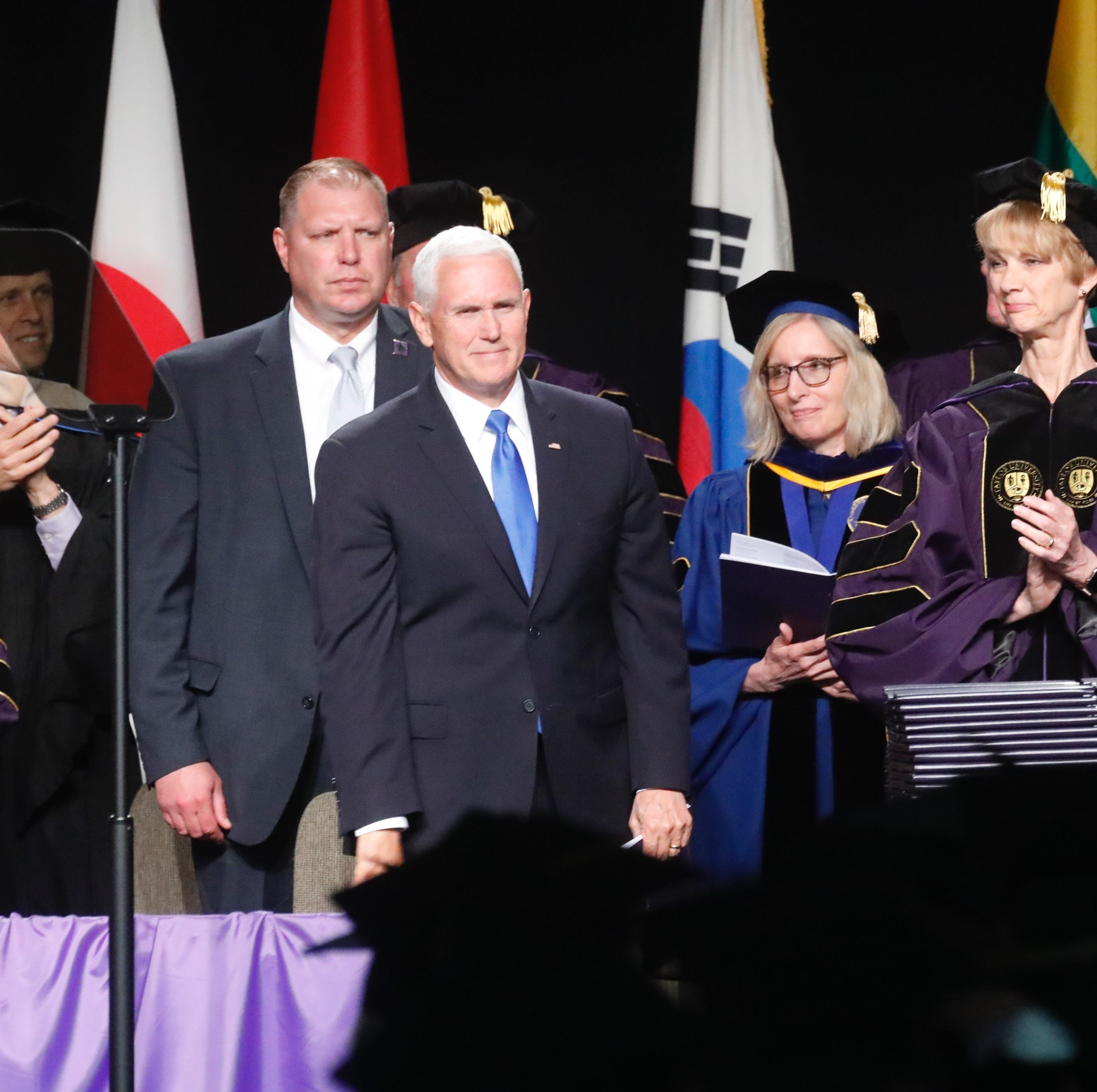 Mike Pence urges Taylor U. grads to 'stand up' for Christianity after dozens walk out on him