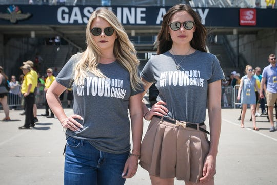 "Hailey McDermott, right, and Ashley Newgarden, left, fiancee and wife of Team Penske drivers Simon Pagenaud and Josef Newgarden, stand in Gasoline Alley at the Indianapolis Motor Speedway, Saturday, May 18, 2019, wearing ""Not YOUR Body, Not YOUR Choice"" t-shirts in response of the recent passing of the restrictive Alabama abortion bill."