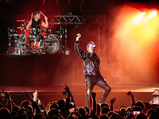 Muse members Matt Bellamy, right, and drummer Dominic Howard are seen during the band's March 23 performance the night before the IndyCar Classic at the Circuit of the Americas in Austin, Texas.
