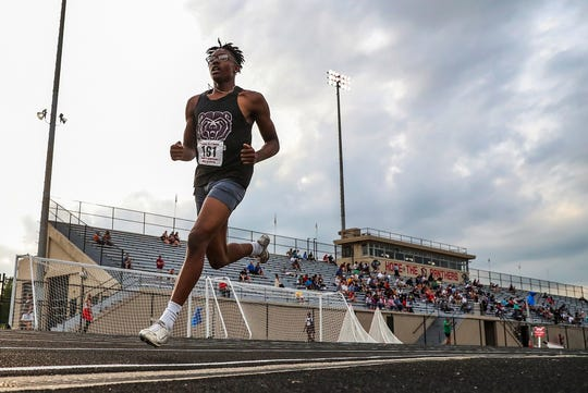 Lawrence Central senior Blaque Rutland competes in the 800 meter dash at IHSAA boys track and field sectionals at North Central High School in Indianapolis on Friday, May 17, 2019.