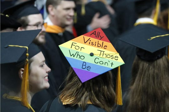 "A graduate sports an ""Ally"" mortarboard during Mike Pence's commencement address at Taylor University Saturday, May 18."