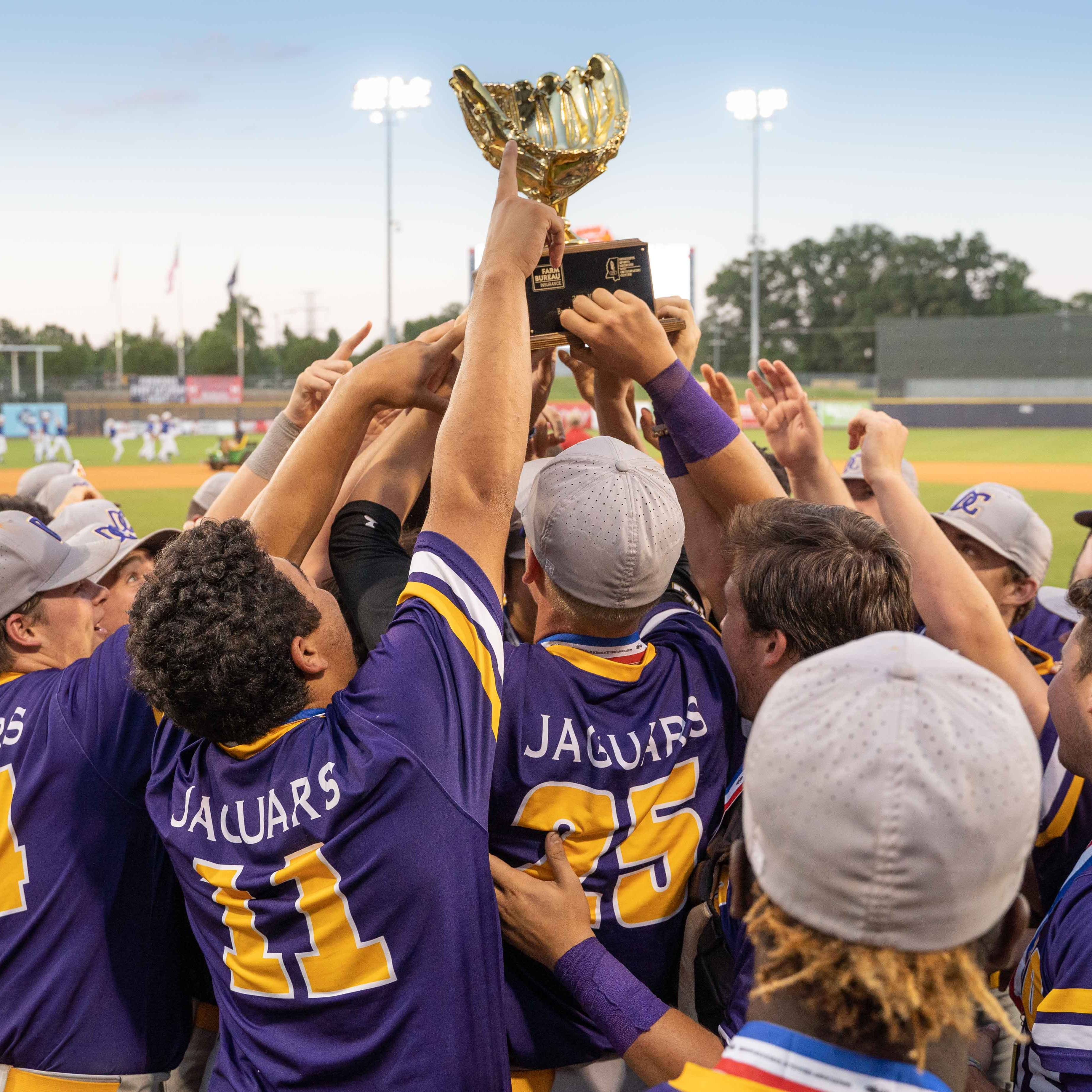 Desoto Central players celebrate with the trophy following their win over St. Martin in the MHSAA 6A Baseball Championship held at the Trustmark Park in Pearl on Friday, May 17, 2019.